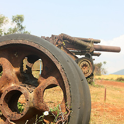 Wheel of T54 tank and abandoned US 155mm artillery piece  at Khe Sanh fire base museum, Vietnam