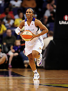 Sep 11, 2011; Phoenix, AZ, USA; Phoenix Mercury guard Temeka Johnson (2) makes a pass while playing against the Minnesota Lynx during the second half at the US Airways Center.  The Lynx defeated the Mercury 96-90. Mandatory Credit: Jennifer Stewart-US PRESSWIRE..