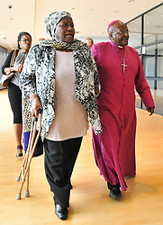 Image ©Licensed to i-Images Picture Agency. 11/08/2014. Cape Town, South Africa. Mrs Leah Tutu and Archbishop Emeritus Desmond Tutu walk arm-in-arm after a press conference announcing the proposed lease of the Granary, a 203 year old building in the centre of Cape Town as the new home of the Desmond and Leah Tutu Legacy Foundation Centre. Picture by Roger Sedres / i-Images