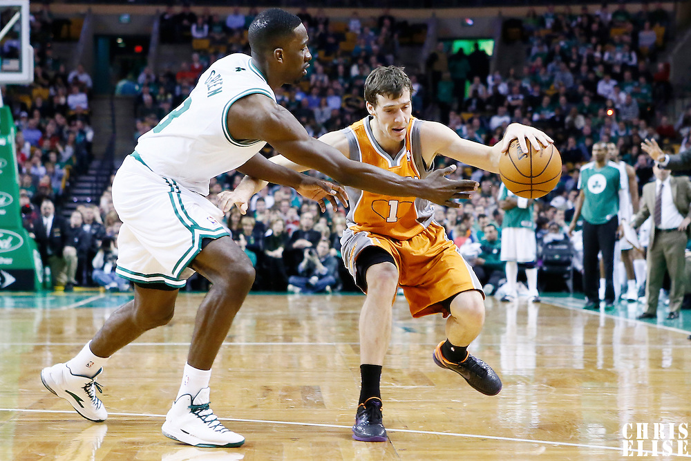 09 January 2013: Phoenix Suns point guard Goran Dragic (1) is fouled by Boston Celtics power forward Jeff Green (8) during the Boston Celtics 87-79 victory over the Phoenix Suns at the TD Garden, Boston, Massachusetts, USA.