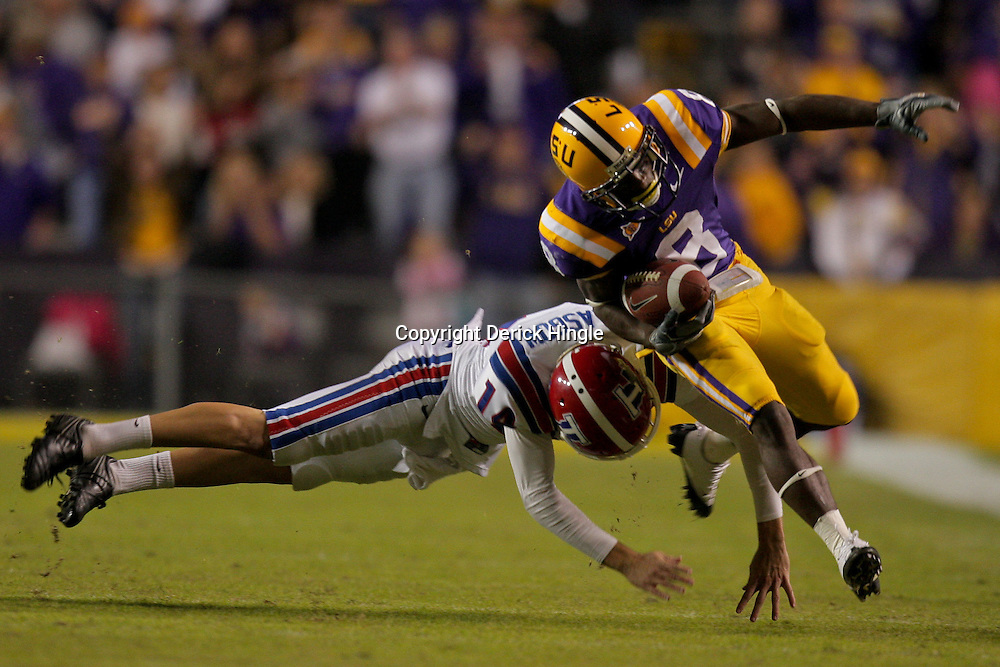 Nov 14, 2009; Baton Rouge, LA, USA; LSU Tigers running back Trindon Holliday (8) is hit by Louisiana Tech Bulldogs punter Cade Glasgow (14) on a return in the third quarter at Tiger Stadium. LSU defeated Louisiana Tech 24-16.  Mandatory Credit: Derick E. Hingle-US PRESSWIRE