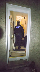 Police take part in an operation against drug dealers in the Stirling area early this morning. Pic of the police inside the property.