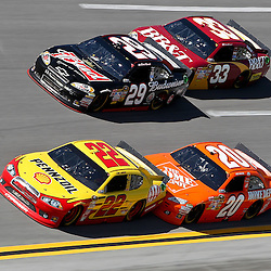 April 17, 2011; Talladega, AL, USA; NASCAR Sprint Cup Series driver Joey Logano (20) drafts Kurt Busch (22) and Clint Bowyer (33) drafts Kevin Harvick (29) during the Aarons 499 at Talladega Superspeedway.   Mandatory Credit: Derick E. Hingle