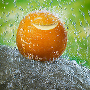 Smiling Orange with raindrops falling on its head Ray Massey is an established, award winning, UK professional  photographer, shooting creative advertising and editorial images from his stunning studio in a converted church in Camden Town, London NW1. Ray Massey specialises in drinks and liquids, still life and hands, product, gymnastics, special effects (sfx) and location photography. He is particularly known for dynamic high speed action shots of pours, bubbles, splashes and explosions in beers, champagnes, sodas, cocktails and beverages of all descriptions, as well as perfumes, paint, ink, water – even ice! Ray Massey works throughout the world with advertising agencies, designers, design groups, PR companies and directly with clients. He regularly manages the entire creative process, including post-production composition, manipulation and retouching, working with his team of retouchers to produce final images ready for publication.