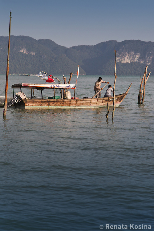 Fishermen take off for a night fishing trip to the Langkawi archipelago in Malaysia