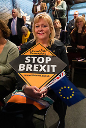© Licensed to London News Pictures. 26/04/2019. London, UK. A Liberal Democrat supporter listens to Leader Vince Cable speaking at the Liberal Democrat party European elections campaign launch held in Tobacco Dock. Liberal Democrat party leader, Vince Cable announced Member of European Parliament (MEP) candidates for the upcoming European Parliament elections that will take place from 23rd to 26th May 2019. Photo credit: Vickie Flores/LNP.