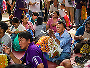 10 SEPTEMBER 2016 - BANGKOK, THAILAND: Residents of Pom Mahakan and their supporters make traditional Thai paper flowers that are used as decorations around temples and villages during a community party in the old fort. Forty-four families still live in the Pom Mahakan Fort community. The city of Bangkok has given them provisional permission to stay, but city officials say the permission could be rescinded and the city go ahead with the evictions. The residents of the historic fort have barricaded most of the gates into the fort and are joined every day by community activists from around Bangkok who support their efforts to stay.                PHOTO BY JACK KURTZ
