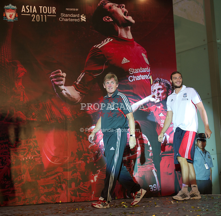 GUANGZHOU, CHINA - Tuesday, July 12, 2011: Liverpool's manager Kenny Dalglish and Andy Carroll during a promotional event for Standard Charter at the Tianhe Shopping Center during day two of the club's Asia Tour. (Photo by David Rawcliffe/Propaganda)