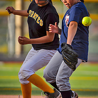 Tiger's Kyshia Dubone (7) makes an error in attempt to tag Pirate's Arianna Begay (11) during the Tiger-Pirate softball game on Wednesday at Ford Canyon Park in Gallup.