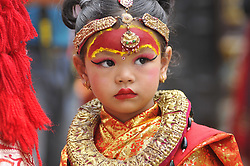 September 4, 2017 - Kathmandu, Nepal - A Portrait of Nepalese young girl impersonate as a Kumari or living Goddess participate during celebration of Kumari puja at Basantapur Durbar Square, Katmandu, Nepal on Monday, September 04, 2017. Altogether 108 young girls under the age of nine gathered for the Kumari puja, a tradition of worshiping, which believes doing puja save small girls from diseases and bad luck in future. (Credit Image: © Narayan Maharjan/Pacific Press via ZUMA Wire)