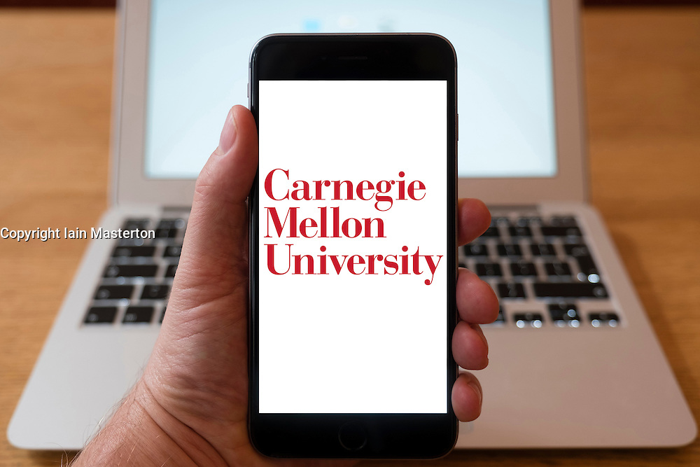 Using iPhone smartphone to display logo of Carnegie Mellon University in Pittsburgh.