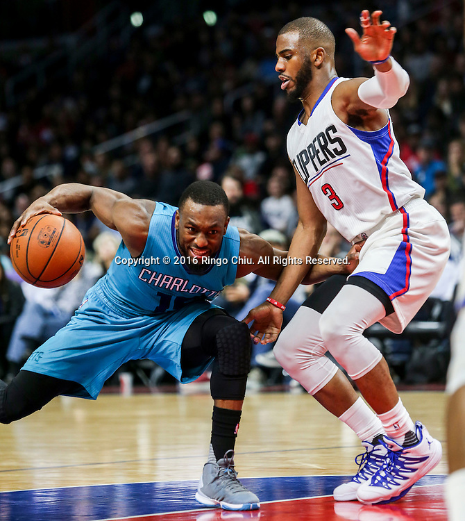 Charlotte Hornets Kemba Walker drives against Los Angeles Clippers Chris Paul during the NBA basketball game in Los Angeles, the United States, Jan. 9, 2016. Los Angeles Clippers won 97-83. (Xinhua/Zhao Hanrong)(Photo by Ringo Chiu/PHOTOFORMULA.com)<br /> <br /> Usage Notes: This content is intended for editorial use only. For other uses, additional clearances may be required.