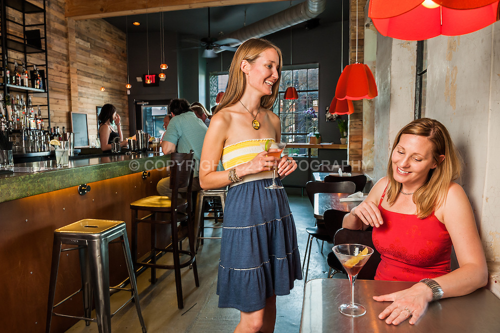 Friends enjoy cocktails in the bar area of The Junction.