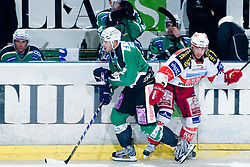 Petr Sachl (HDD Tilia Olimpiija, #12) and Dieter Kalt (EC KAC, #74) during ice-hockey match between HDD Tilia Olimpija and EC KAC in 32nd Round of EBEL league, on December 30, 2010 at Hala Tivoli, Ljubljana, Slovenia. (Photo By Matic Klansek Velej / Sportida.com)