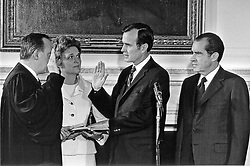 Washington, D.C - February 26, 1971 -- George H.W. Bush is sworn-in as United States Ambassador to the United Nations in Washington, D.C. on February 26, 1971. From left to right: Associate Justice of the United States Supreme Court Potter Stewart, Mrs. George H.W. Bush (Barbara), George H.W. Bush, United States President Richard M. Nixon.Photo by White House/CNP/ABACAPRESS.COM