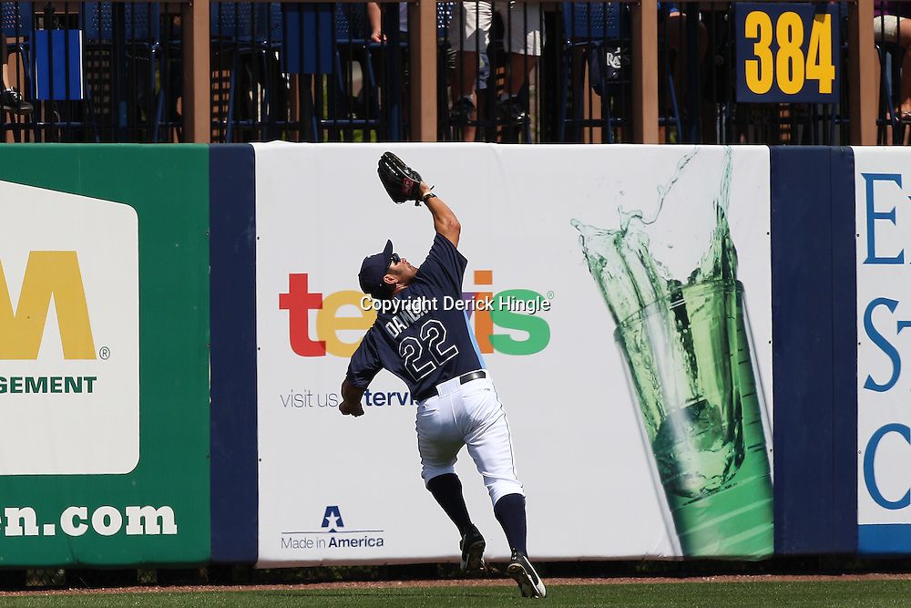 March 15, 2011; Port Charlotte, FL, USA; Tampa Bay Rays left fielder Johnny Damon (22) makes a catch during a spring training exhibition game against the Florida Marlins at Charlotte Sports Park.   Mandatory Credit: Derick E. Hingle