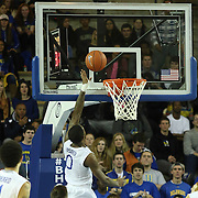 Delaware Guard Davon Usher (0) drives to the hoop in the second half of a NCAA regular season Colonial Athletic Association conference game between Delaware and The College of Charleston Wednesday, Feb 5, 2014 at The Bob Carpenter Sports Convocation Center in Newark Delaware.