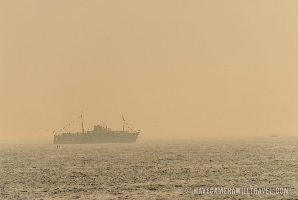 A ship heads into the heavy haze on Istanbul's Bosphorus Strait.