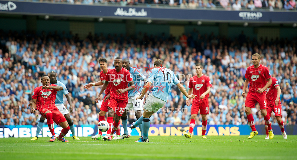 MANCHESTER, ENGLAND - Sunday, August 19, 2012: Manchester City's Edin Dzeko scores the second goal against Southampton, to level the scores 2-2, during the Premiership match at the City of Manchester Stadium. (Pic by David Rawcliffe/Propaganda)