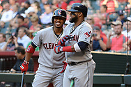 PHOENIX, AZ - APRIL 08:  Francisco Lindor #12 and Carlos Santana #41 of the Cleveland Indians smile in the on deck circle in the first inning of the MLB game against the Arizona Diamondbacks at Chase Field on April 8, 2017 in Phoenix, Arizona.  (Photo by Jennifer Stewart/Getty Images)