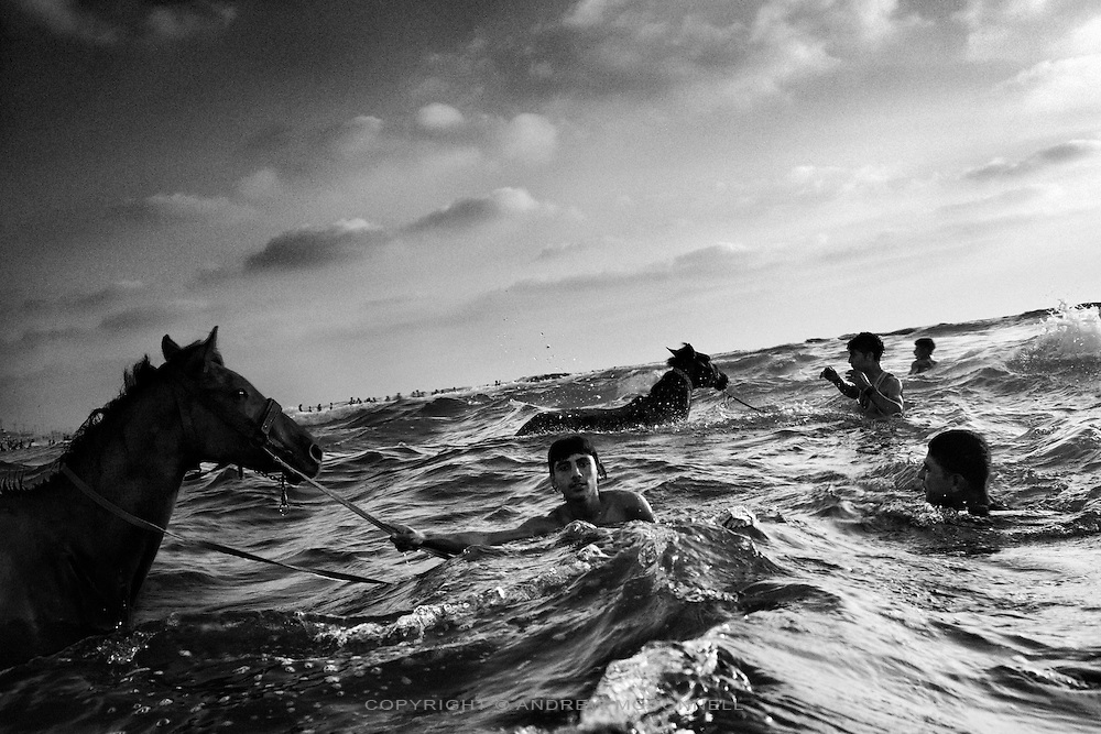 Horses and their owners take a dip in the Mediterranean Sea off Gaza City, Gaza Strip. The sea is a much needed distraction from the struggles of daily life in Gaza.