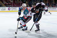 KELOWNA, CANADA - MARCH 7: Aidan Barfoot #21 of the Vancouver Giants stick checks Conner Bruggen-Cate #20 of the Kelowna Rockets curling first period on March 7, 2018 at Prospera Place in Kelowna, British Columbia, Canada.  (Photo by Marissa Baecker/Shoot the Breeze)  *** Local Caption ***