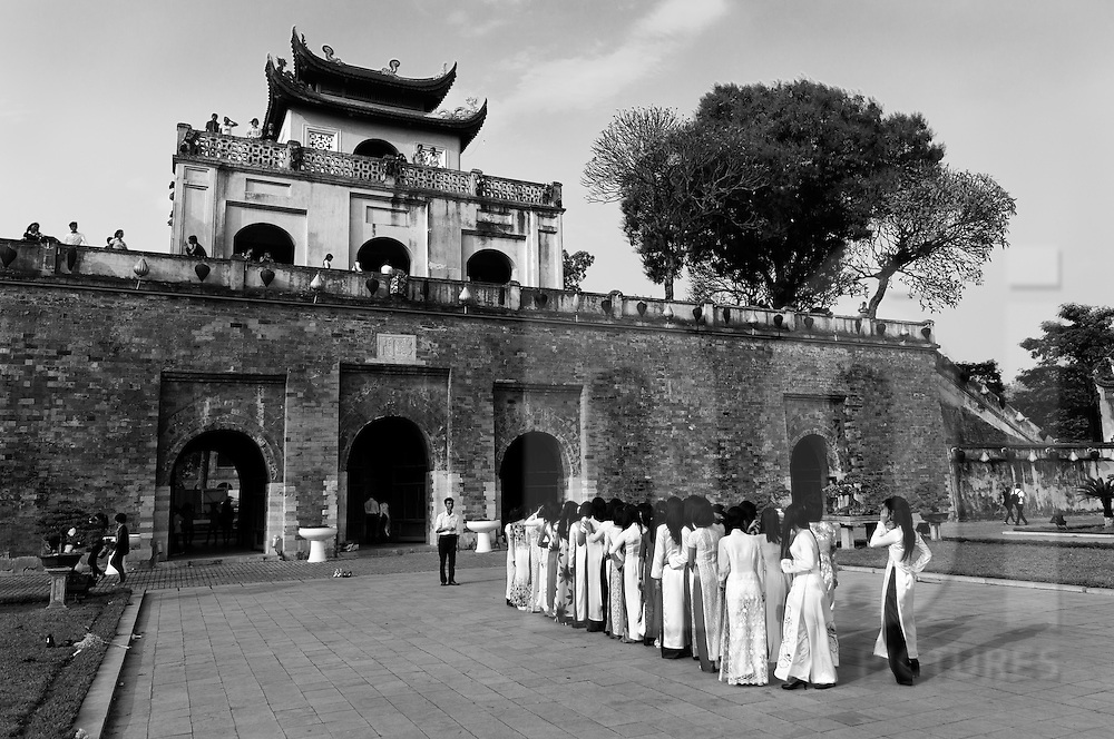 Female university students pose for gradiation photos in traditional Ao Dai at the Hanoi Citadel, Vietnam, Southeast Asia