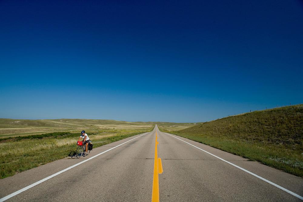 Alexis Erkert cycling. Highway 20, Cherry County, Nebraska, 8/30/2007 Photo by Ben Depp