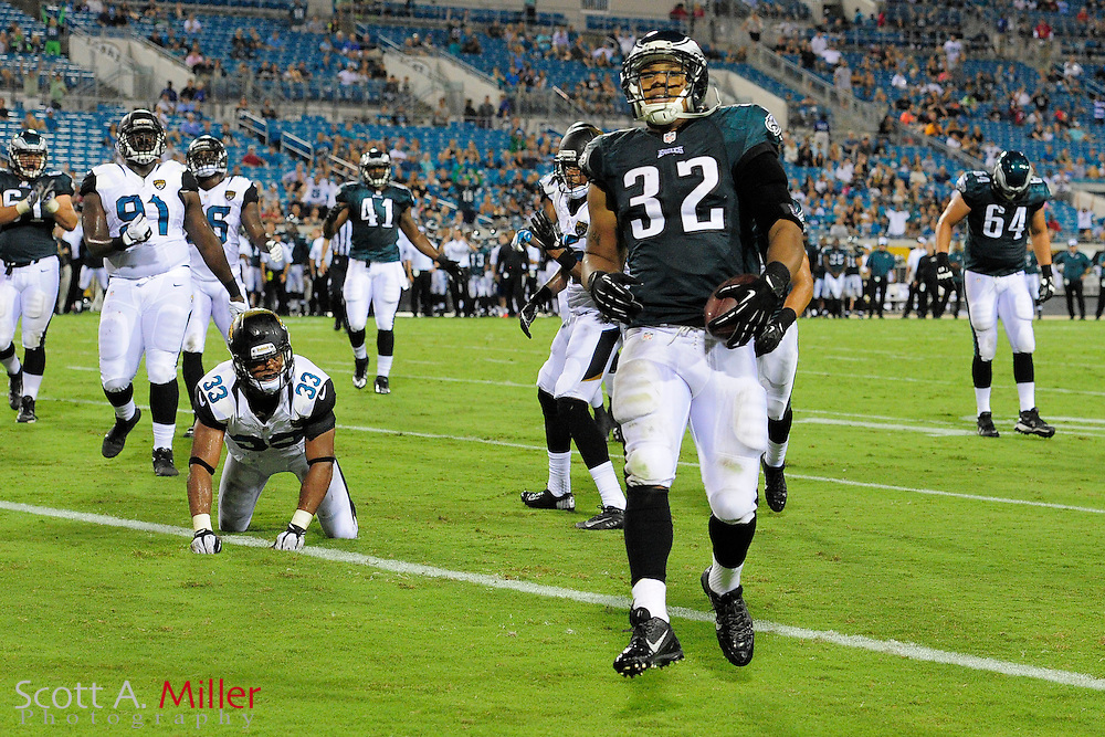 Philadelphia Eagles running back Chris Polk (32) scores the winning touchdown during a preseason NFL game against the Jacksonville Jaguars at EverBank Field on Aug. 24, 2013 in Jacksonville, Florida. The Eagles won 31-24.<br /> <br /> &copy;2013 Scott A. Miller