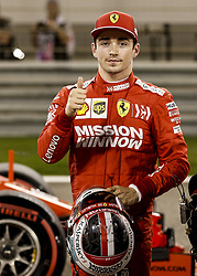 March 30, 2019 - Sakhir, Bahrain - Scuderia Ferrari driver CHARLES LECLERC celebrates his first F1 pole position, after qualifying for the Formula One Grand Prix of Bahrain. LeClerc also set a lap record of the Sakhir Circuit. (Credit Image: © Hoch Zwei via ZUMA Wire)