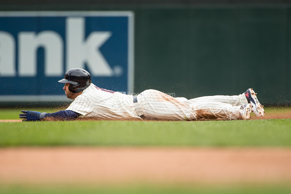MINNEAPOLIS, MN- APRIL 5: Brian Dozier #2 of the Minnesota Twins slides and steals second base against the Kansas City Royals on April 5, 2017 at Target Field in Minneapolis, Minnesota. The Twins defeated the Royals 9-1. (Photo by Brace Hemmelgarn) *** Local Caption *** Brian Dozier