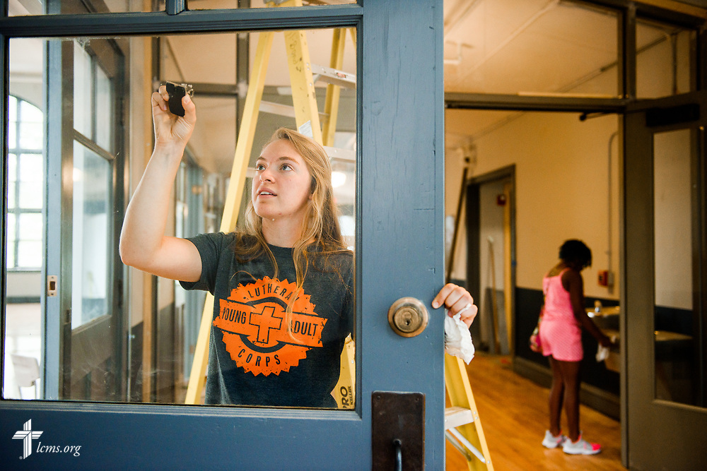 Megan Barz of Lutheran Young Adult Corps cleans windows as she serves with volunteers on Thursday, Aug. 10, 2017, at Eagle College Prep in south St. Louis. LCMS Communications/Erik M. Lunsford