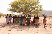 Himba tribeswomen at a funeral gathering, Kaokoland, Namibia