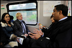 London Mayor Boris Johnson on the train with his wife Marina Johnson on the final week of his Mayoral Campaign, London, UK, April 21, 2012. Photo By Andrew Parsons / i-Images.