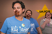 Principal Aaron Dominguez, left, and staff have pudding on their faces after a contest during a pep rally to energize students for STAAR testing at Garcia Elementary School, March 27, 2014.