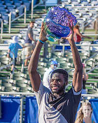 February 25, 2018 - Delray Beach, FL, US - FRANCIS TIAFOE (US) holds winning trophy in the Delray Beach Open Men's Single Final at the Delray Beach Tennis Stadium. TIAFOE won beating PETER.GOJOWCZYK (Ger) 6-1, 6-4. (Credit Image: © Arnold Drapkin via ZUMA Wire)
