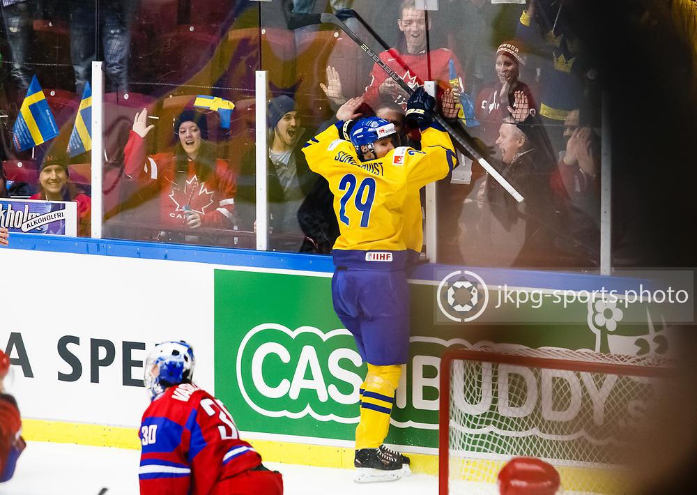 140104 Ishockey, JVM, Semifinal,  Sverige - Ryssland<br /> Icehockey, Junior World Cup, SF, Sweden - Russia.<br /> Oskar Sundqvist, (SWE) celebrates making goal 2-0 together with the fans.<br /> m&aring;l, jubel, jublar, k&auml;nslor.<br /> Endast f&ouml;r redaktionellt bruk.<br /> Editorial use only.<br /> &copy; Daniel Malmberg/Jkpg sports photo