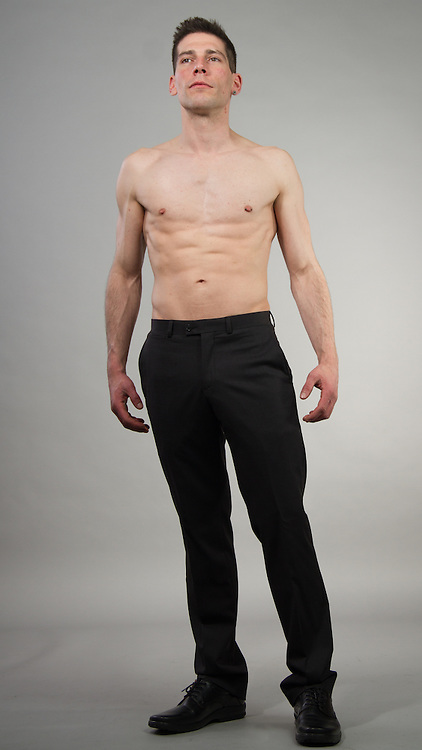 Young man posing shirtless and in black pants.