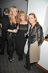 Left to right, MELISSA ODABASH, KELLY HOPPEN and AMANDA KYME at a dinner hosted by Ruinart Champagne for Yasmin Mills at Nobu, Park Lane, London on rth May 2009.