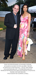 Writer SALMAN RUSHDIE and PADMA LAKSHMI, at a party in London on 2nd July 2003. PLB 347