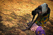 12-03-27   -- KITGUM, UGANDA --  A woman soothes nodding disease victim Monica Auma, 16, at the Okidi Central Village Health Centre near Kitgum, Uganda on Tuesday, March 27. When the disease presents itself, Auma hallucinates that she is being surrounded by people who then drag her to water and submerge her.  After running and screaming I don't want to go, Jesus save me, Auma collapses unconscious. Photo by Daniel Hayduk