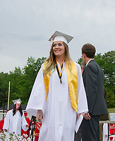 Emily Gray looks out to the crowd after receiving her diploma at LHS Commencement Friday evening.  (Karen Bobotas/for the Laconia Daily Sun)