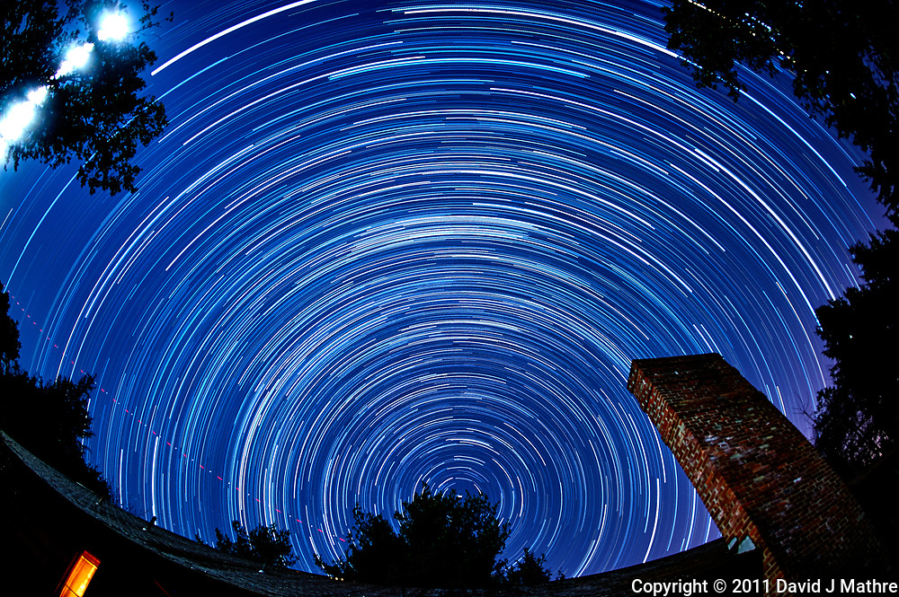 Early morning star trails looking north. Autumn night sky in New Jersey. Composite of 158 images taken with a Nikon D3 camera and 16 mm f/2.8 fisheye lens (ISO 400, 16 mm, f/4, 59 sec).