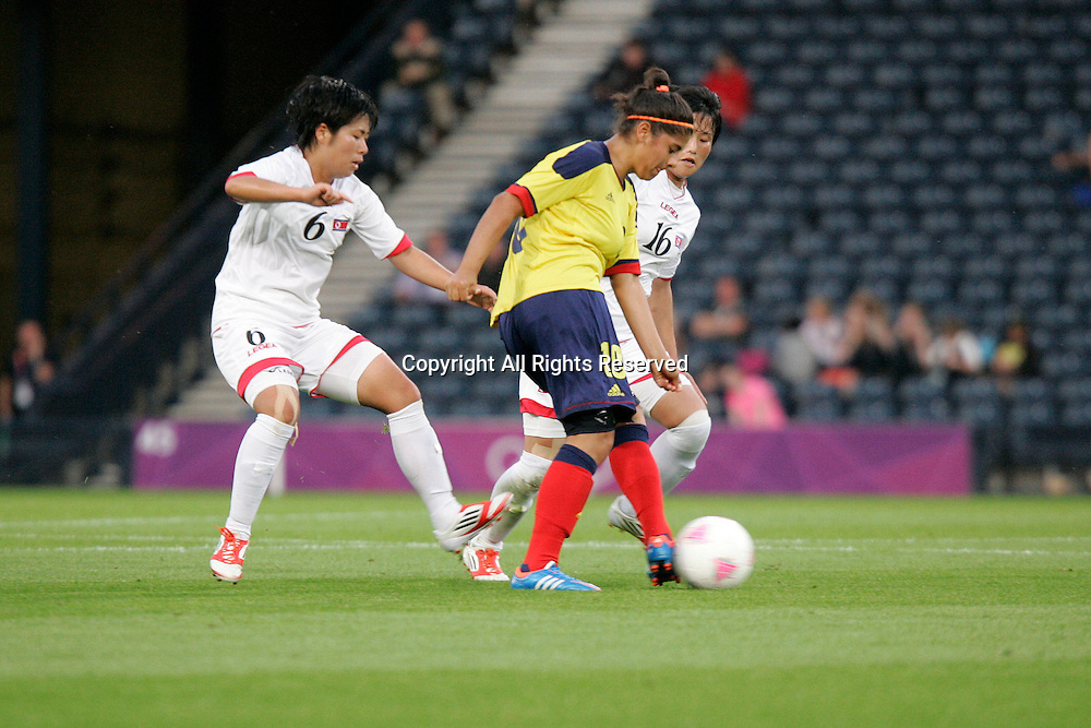 25.07.2012 Glasgow, Scotland.  10 Catalina Usme and 6 Choe Un-Ju in action during the Olympic Football Women's Preliminary game between Columbia and Korea from Hampden Park. The game kicked off 1 hour late when the South Korean flag was raised in error.