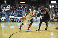 "Mississippi's LaDarius White (10) vs. Missouri's Earnest Ross (33) at the C.M. ""Tad"" Smith Coliseum in Oxford, Miss. on Saturday, February 8, 2014. (AP Photo/Oxford Eagle, Bruce Newman)"