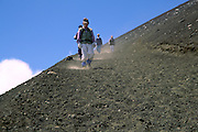 Japanese climbers descending dusty paths down from  the summit of Mount Fuji, at 3,776 metres, the highest peak in Japan. Yamanashi prefecture. Japan August 2005