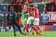 Charlton Athletic goalkeeper Dillon Phillips (1) celebrates with teammates after winning the match 4-3 on penalties during the EFL Sky Bet League 1 second leg Play-Off match between Charlton Athletic and Doncaster Rovers at The Valley, London, England on 17 May 2019.