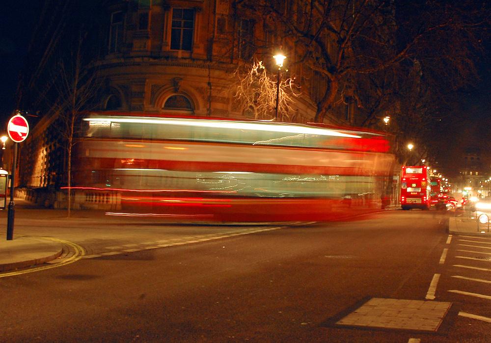 blurred shot of london bus moving at night