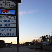 RAY VAN DUSEN/BUY AT PHOTOS.MONROECOUNTYJOURNAL.COM<br /> A thermometer at Aberdeen's Robin's Unique Boutique shows a temperature of 14 degrees as the sun begins to rise last Tuesday morning. Temperatures and wind chills dipped into the single digits across North Mississippi last week as part of cold snaps felt throughout the nation.