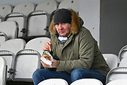 Leeds United fan getting a bite to eat before the The FA Cup 3rd round match between Queens Park Rangers and Leeds United at the Loftus Road Stadium, London, England on 6 January 2019.